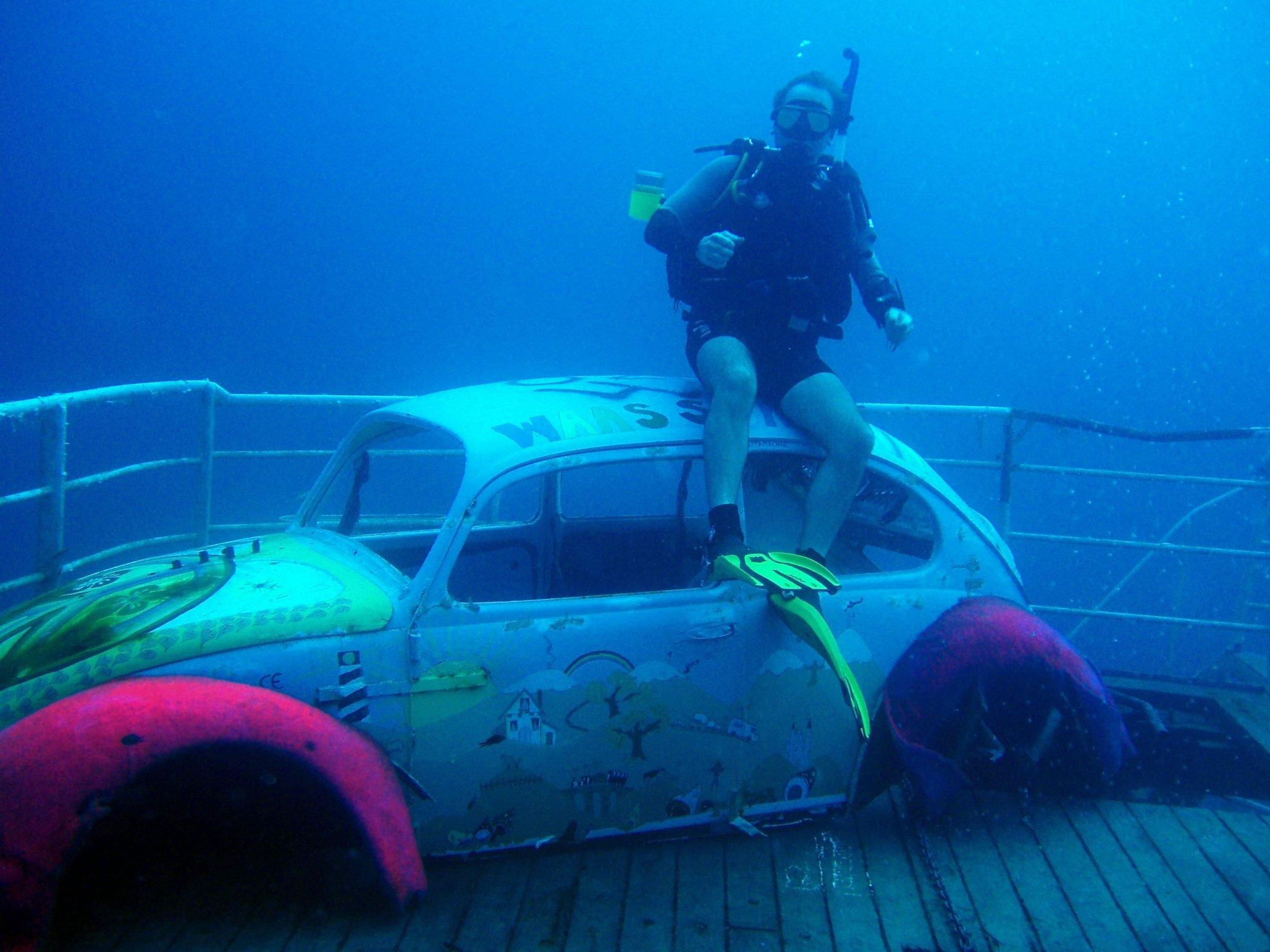 wreck diver on VW on deck of MV Karwela