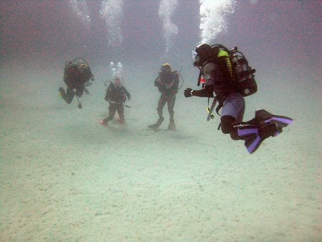 Scuba divers in Marsalforn Bay