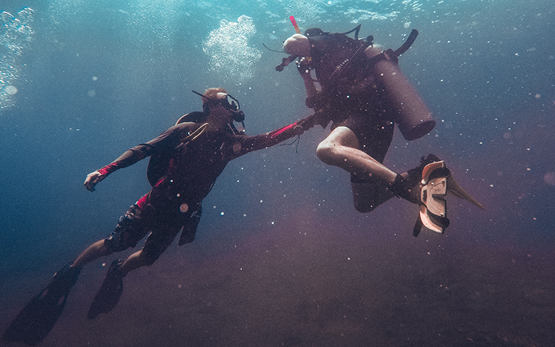 scuba divers on a Malta diving holiday